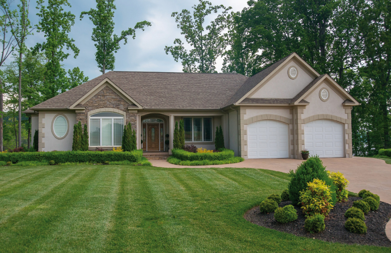 Home tour offers taste of lakeside living central for Houses with stone accents
